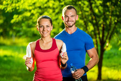 Athletic man and woman after fitness exercise royalty free stock photography