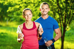 Athletic man and woman after fitness exercise Royalty Free Stock Image
