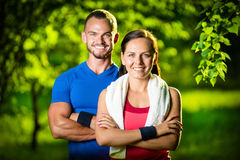 Athletic man and woman after fitness exercise Stock Image