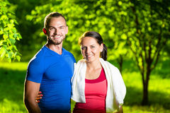 Athletic man and woman after fitness exercise Stock Photos