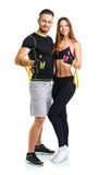 Athletic man and woman after fitness exercise with a thumb up on Stock Images