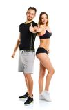 Athletic man and woman after fitness exercise with a thumb up on. Athletic men and women after fitness exercise with a thumb up on the white background royalty free stock images