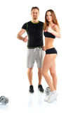 Athletic man and woman after fitness exercise with thumb up on t. Athletic men and women after fitness exercise with thumb up on the white background royalty free stock photography