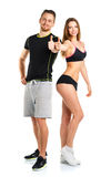 Athletic man and woman after fitness exercise with thumb up on t. Athletic men and women after fitness exercise with thumb up on the white background royalty free stock images