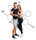 Athletic man and woman after fitness exercise with a thumb up wi. Athletic men and women after fitness exercise with a finger up on the white with the chemical royalty free stock photo