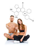 Athletic man and woman after fitness exercise with a thumb up wi. Athletic men and women after fitness exercise with a finger up on the white with the chemical stock photos