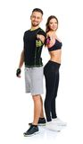 Athletic man and woman after fitness exercise with thumbs up on. Athletic men and women after fitness exercise with thumbs up on the white background stock images