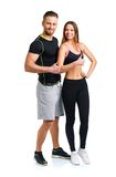 Athletic man and woman after fitness exercise with thumbs up on. Athletic men and women after fitness exercise with thumbs up on the white background stock image