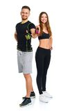 Athletic man and woman after fitness exercise with thumbs up on Royalty Free Stock Photography