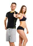 Athletic man and woman after fitness exercise with thumbs up on. Athletic men and women after fitness exercise with thumbs up on the white background royalty free stock photo