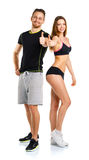Athletic man and woman after fitness exercise with thumbs up on. Athletic men and women after fitness exercise with thumbs up on the white background royalty free stock photos