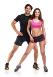 Athletic man and woman after fitness exercise on the white backg Royalty Free Stock Images