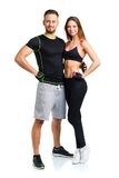 Athletic man and woman after fitness exercise on the white Stock Photos