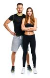 Athletic man and woman after fitness exercise on the white Stock Image