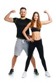 Athletic man and woman after fitness exercise on the white. Athletic men and women after fitness exercise on the white background royalty free stock photography