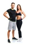 Athletic man and woman after fitness exercise on the white Stock Photography