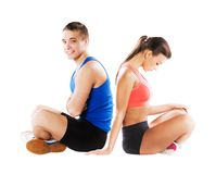Athletic man and woman. Athletic men and women before fitness exercise stock images