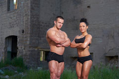 Athletic man and woman outdoors Stock Photography
