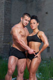 Athletic man and woman outdoors Royalty Free Stock Image