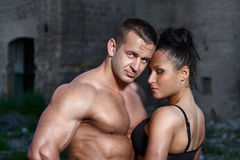 Athletic man and woman outdoors Stock Images