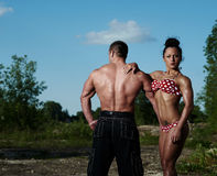 Athletic man and woman outdoors Royalty Free Stock Images