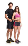 Athletic man and woman with thumb up on the white Royalty Free Stock Photo