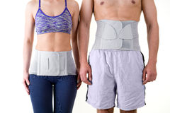 Athletic Man and Woman Wearing Back Support Braces Royalty Free Stock Photos