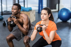 Athletic man and woman working out Royalty Free Stock Photos