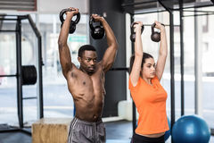 Athletic man and woman working out Stock Images
