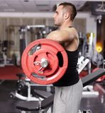 Athletic man working with barbell Stock Photo
