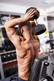 Athletic man working with heavy dumbbell Stock Photo