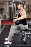 Athletic man working with heavy dumbbells Stock Images