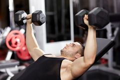 Athletic man working his chest Stock Image