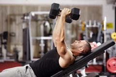 Athletic man working his chest Royalty Free Stock Images