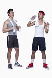 Athletic man and workout beginner, tired,  opposite, studio shot Stock Images