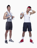 Athletic man and workout beginner tired, opposite, studio shot Stock Photography