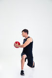 Athletic man workout with fitness ball. Full length portrait of athletic man workout with fitness ball isolated on a white background Royalty Free Stock Photography