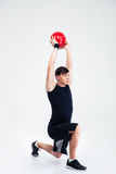 Athletic man workout with fitness ball. Full length portrait of athletic man workout with fitness ball isolated on a white background Stock Images