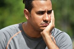 Athletic Man And Worry. A handsome adult hispanic man Stock Photos