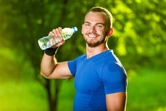 Athletic mature man drinking water from a bottle Royalty Free Stock Images