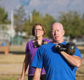 Athletic Mature Man Lifting Weights Stock Photography