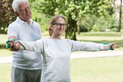 Athletic mature pair exercising together Stock Photo