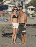 Athletic middle-aged couple in the sun on the beach Stock Images
