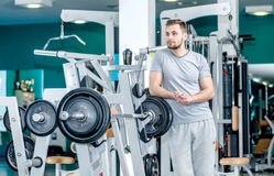 Athletic morning. A handsome man with a beard standing near the Royalty Free Stock Images