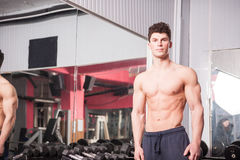 Athletic muscular guy in the gym Stock Photo