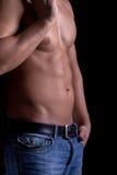 Athletic muscular man posing Royalty Free Stock Image