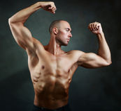 Athletic muscular man Stock Images