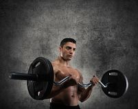 Athletic man training biceps Royalty Free Stock Images