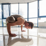Athletic muscular young man working out, yoga Stock Photos