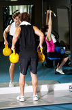 Athletic people working out with equipments Royalty Free Stock Photo